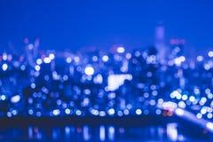 Sumário do fundo da luz da cidade do borrão Imagem de Stock