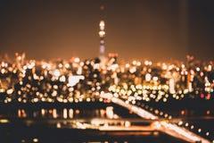 Sumário do fundo da luz da cidade do borrão Fotos de Stock Royalty Free