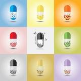 Sumário próximo acima únicas das cápsulas verticais coloridas e conceptuais ajustadas Foto de Stock