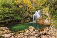 Sum waterfall in the Vintgar Canyon in Slovenia,Europe. Sum waterfall and wooden bridge in the Vintgar Canyon in Slovenia,Europe Royalty Free Stock Photo