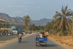 SUMBE/ANGOLA 10 OCT 2017 African family to travel by motorcycle. royalty free stock photography