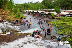Sumber Maron - spring water spa with waterfall and swimming pools. East Java, Indonesia - July 11, 2018: Sumber Maron - natural spring water spa with waterfall Royalty Free Stock Photo