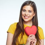Sumbol of love. Smiling woman holding heart. Isolated portrait of beautiful girl with long hair Royalty Free Stock Image