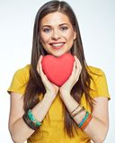 Sumbol of love. Smiling woman holding heart. Isolated portrait of beautiful girl with long hair Royalty Free Stock Images