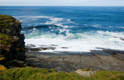 Sumbrugh head coastline. Scenic view of waves breaking on Sumburgh Head coastline, Shetland Islands, Scotland Stock Images