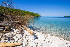 Sumer in Bruce Peninsula National Park Ontario Canada. Crystal water and white stony coastline at Bruce Peninsula National Park Ontario Canada stock photography