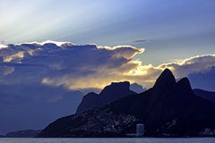 Sumer sunset with cloudy sky. Summer sunset with cloudy sky with Two Brothers hill and Vidigal slum view from Ipanema beach at Rio de Janeiro Royalty Free Stock Photos