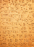 Sumerian artifact. Ancient sumerian stone carving with cuneiform scripting Stock Images