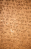 Sumerian artifact. Ancient sumerian stone carving with cuneiform scripting Royalty Free Stock Photo