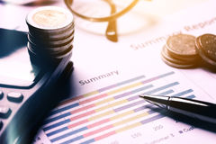 Summary report and business equipment on desk with finance savin Royalty Free Stock Image