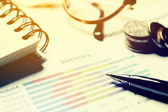 Summary report and financial analyzing concept, Pen and notebook Royalty Free Stock Images