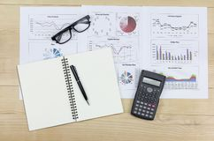 Summary report and financial analyzing order market plan. Concept, pen and calculator with on paperwork Royalty Free Stock Images