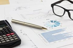 Summary report and financial analyzing order product plan concep. T, pen and calculator with on paperwork Stock Image