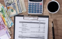 Summary report with money, pen, calculator. And cup of coffee Stock Image