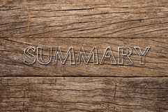 Summary written over wooden background Stock Images