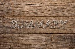 summary written over wooden background