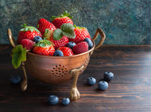 Summe freshr berries in bowl. Summer berries in bowl on wooden table, strawberry, raspberry and blueberry. Selective focus Royalty Free Stock Images