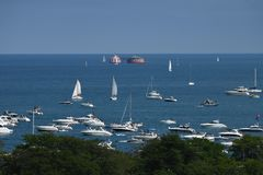 A Summer's Afternoon on Lake Michigan. This is a Summer picture of boats on Lake Michigan off Lincoln Park with a water crib in the background located in Stock Image