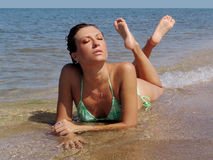 Summer. Young woman relaxing on the beach Royalty Free Stock Photography