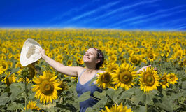Summer. Young beautiful woman in a sunflower field Stock Images