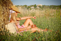 Summer. Young woman relaxing in field outdoors in summer Stock Image