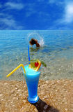 Summer. Beautiful fruit cocktail at the sunny beach stock images