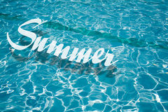 Summer. Word Summer floating on the water Royalty Free Stock Image