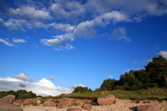 Summer. The blue cloudy sky on a coast of the Baltic sea Royalty Free Stock Photos