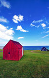 Summer. Lanscape with red house, green grass and blue skies Royalty Free Stock Image