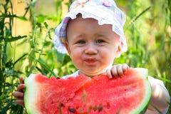 Summer. Little girl eat water-melon Stock Photos