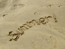 Summer!. Writing in the sand Royalty Free Stock Images
