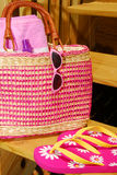 Summer Accessories. Brightly colored beach bag, sunglasses and sandals ready for the beach or pool Stock Photos