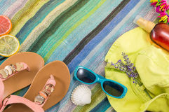 Summer accessories on beach towel Royalty Free Stock Photo