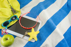 Summer accessories on beach towel Royalty Free Stock Images