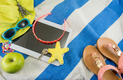 Summer accessories on beach towel Royalty Free Stock Image
