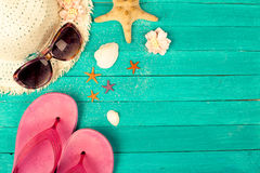 Summer accessories on blue wooden background Stock Photo