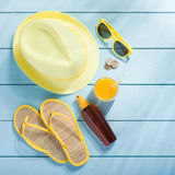 Summer accessories on blue wooden background Stock Photography