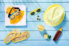 Summer accessories on blue wooden background. Top view Royalty Free Stock Photography