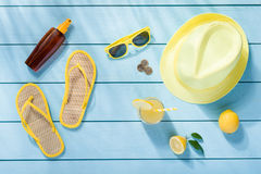 Summer accessories on blue wooden background. Top view Stock Photos