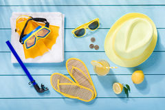 Summer accessories on blue wooden background. Top view Royalty Free Stock Images