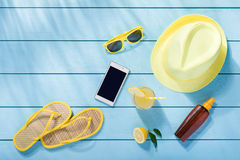 Summer accessories on blue wooden background. Top view Royalty Free Stock Image