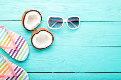 Summer accessories on blue wooden background. Top view and copy space royalty free stock image