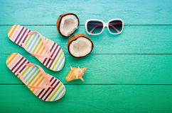 Summer accessories and coconuts on blue wooden floor with copy space. Top view Royalty Free Stock Images