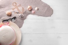 Summer accessories with decorative wooden anchor and sea shells stock images