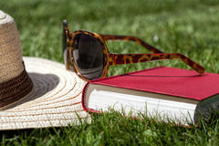 Summer accessories on a grass Royalty Free Stock Images