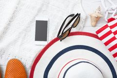 Summer accessories hat and bag on white wooden background. Royalty Free Stock Photo