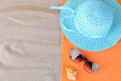 Summer accessories. Hat and sunglasses and a towel on the sea. stock photo