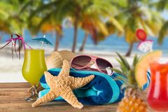 Summer accessories on sandy beach. Stock Photo