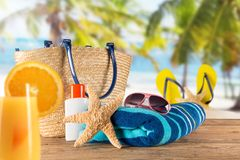 Summer accessories on sandy beach. Stock Images