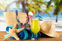 Summer accessories on sandy beach. Royalty Free Stock Photography